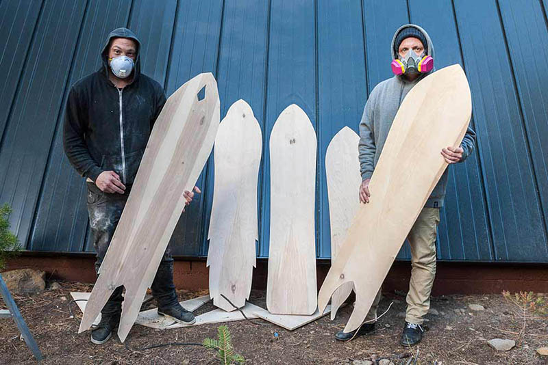 Mike Parillo and Corey Smith stand with freshly cut out boards.