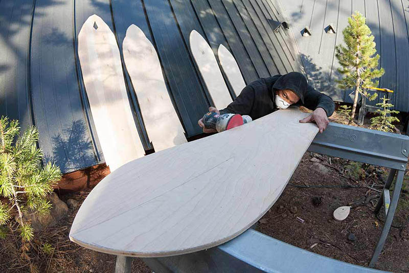 Mike Parillo sands the perfect side into a deck.
